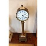 A 19th c pillar mantle clock with alarm
