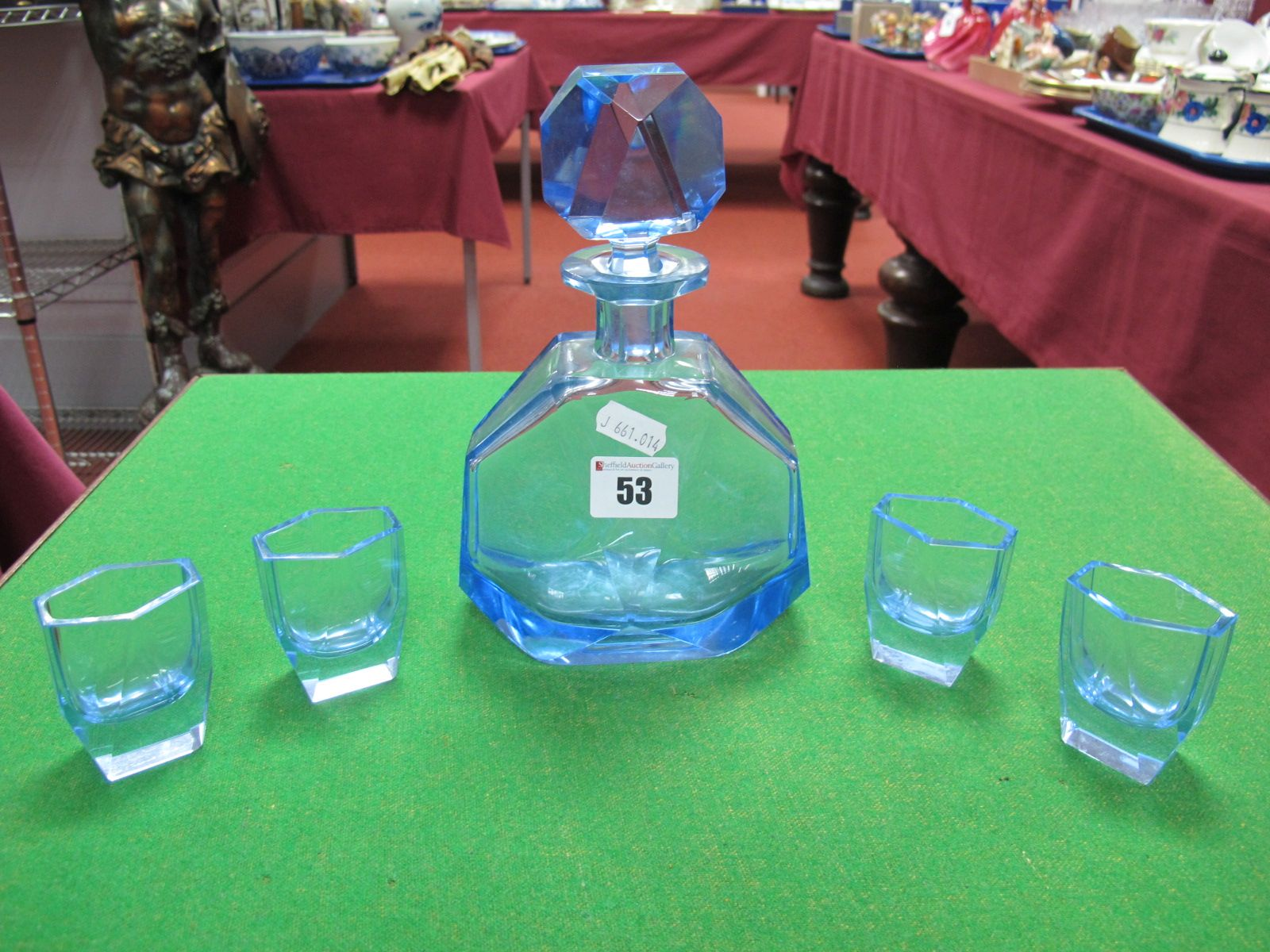 Lot 53 - An Art Deco Blue Glass Faceted Hexagonal Decanter, and four matching tots.