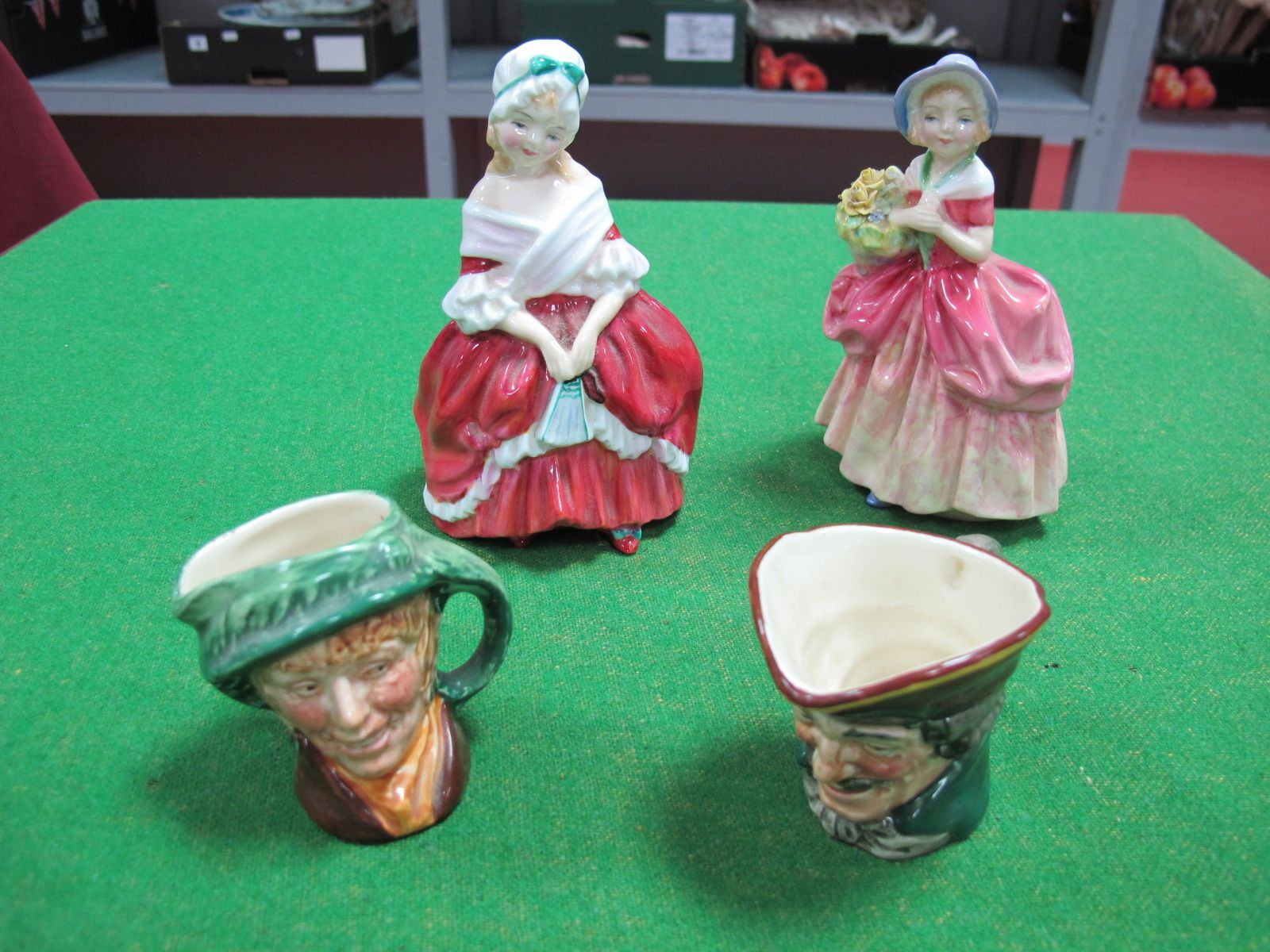 "Lot 49 - Royal Doulton Figures ""Peggy"", HN 2038, and ""Cissie"" HN 1809; two Royal Doulton small character jugs"