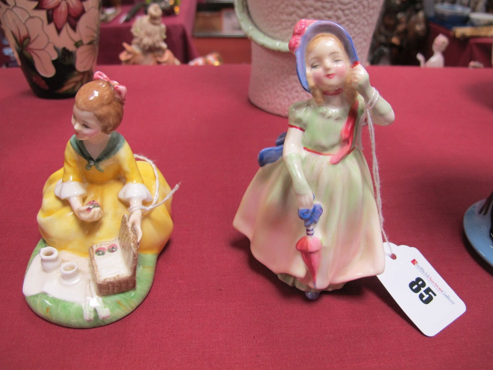 Lot 85 - Two Royal Doulton Figurines 'Picnic' HN2308 and 'Babie' HN1679. (2)
