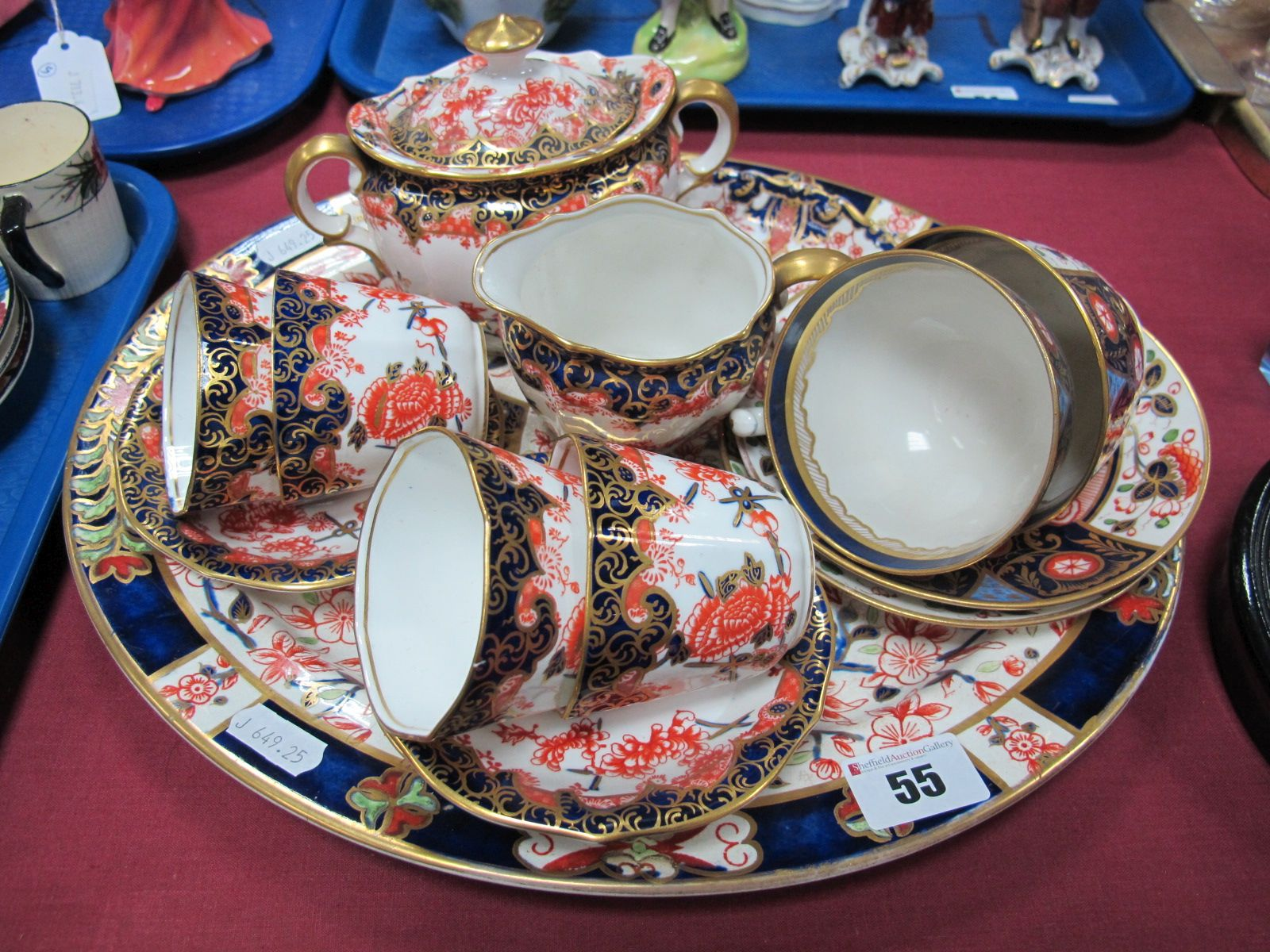 Lot 55 - A Royal Crown Derby Imari Part China Coffee Service, comprising four cups and saucers, milk and