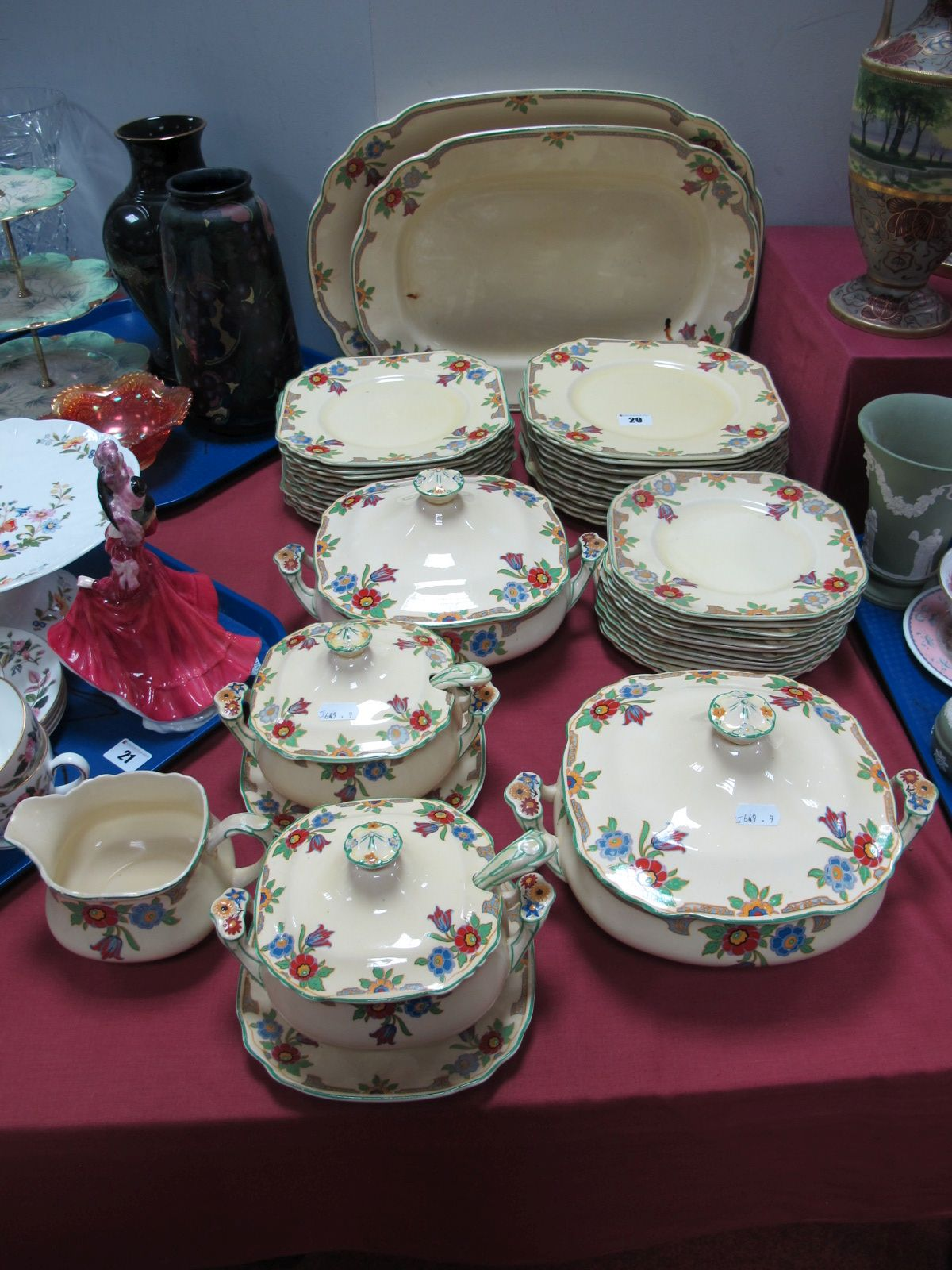 Lot 20 - A Wedgwood Imperial Porcelain Dinner Service, decorated with an Art Deco style stylised floral