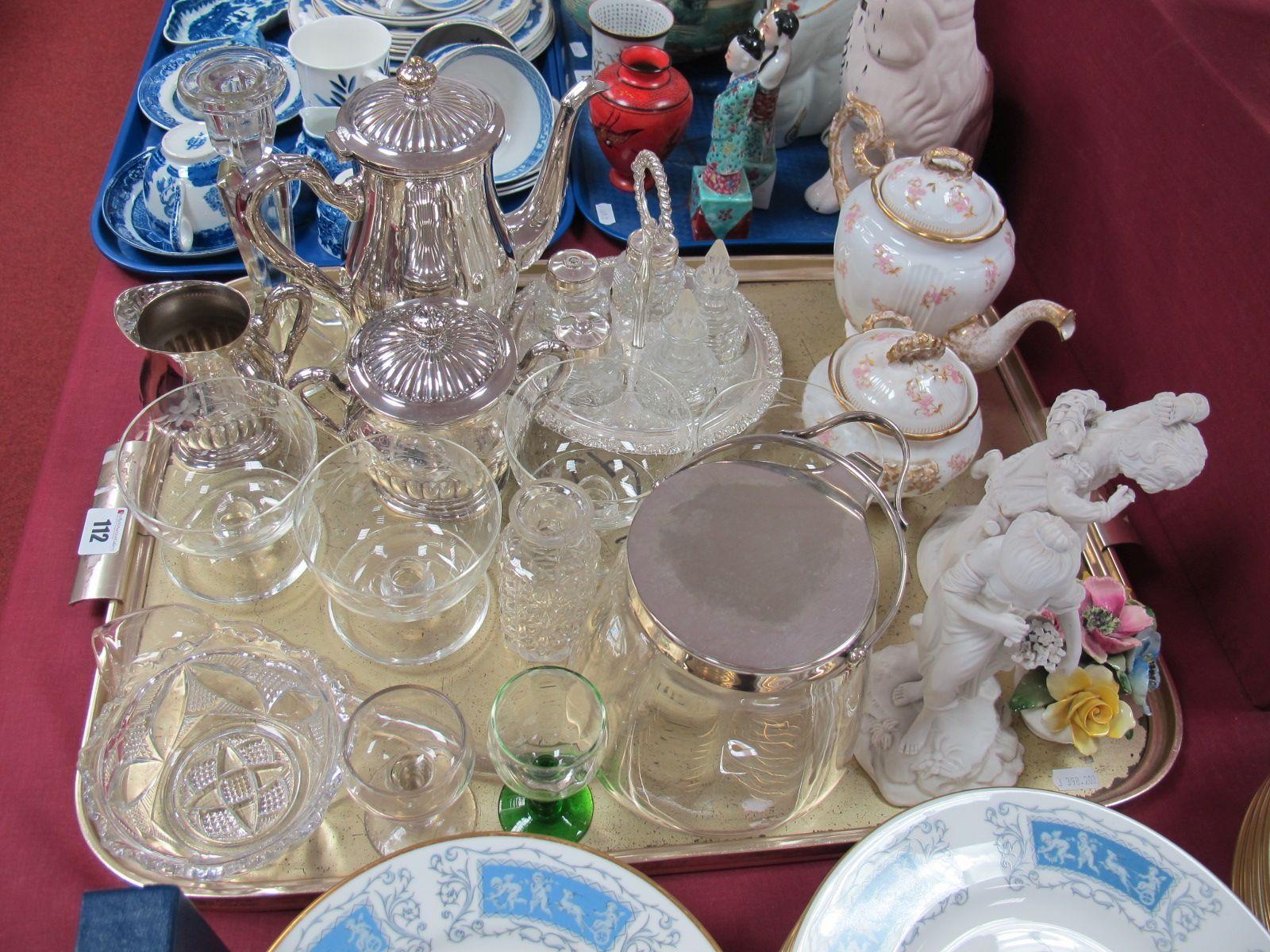 Lot 112 - A Plated Three Piece Tea Service, Limogue teapot, sucrier, plated five bottle cruet, pair of XIX