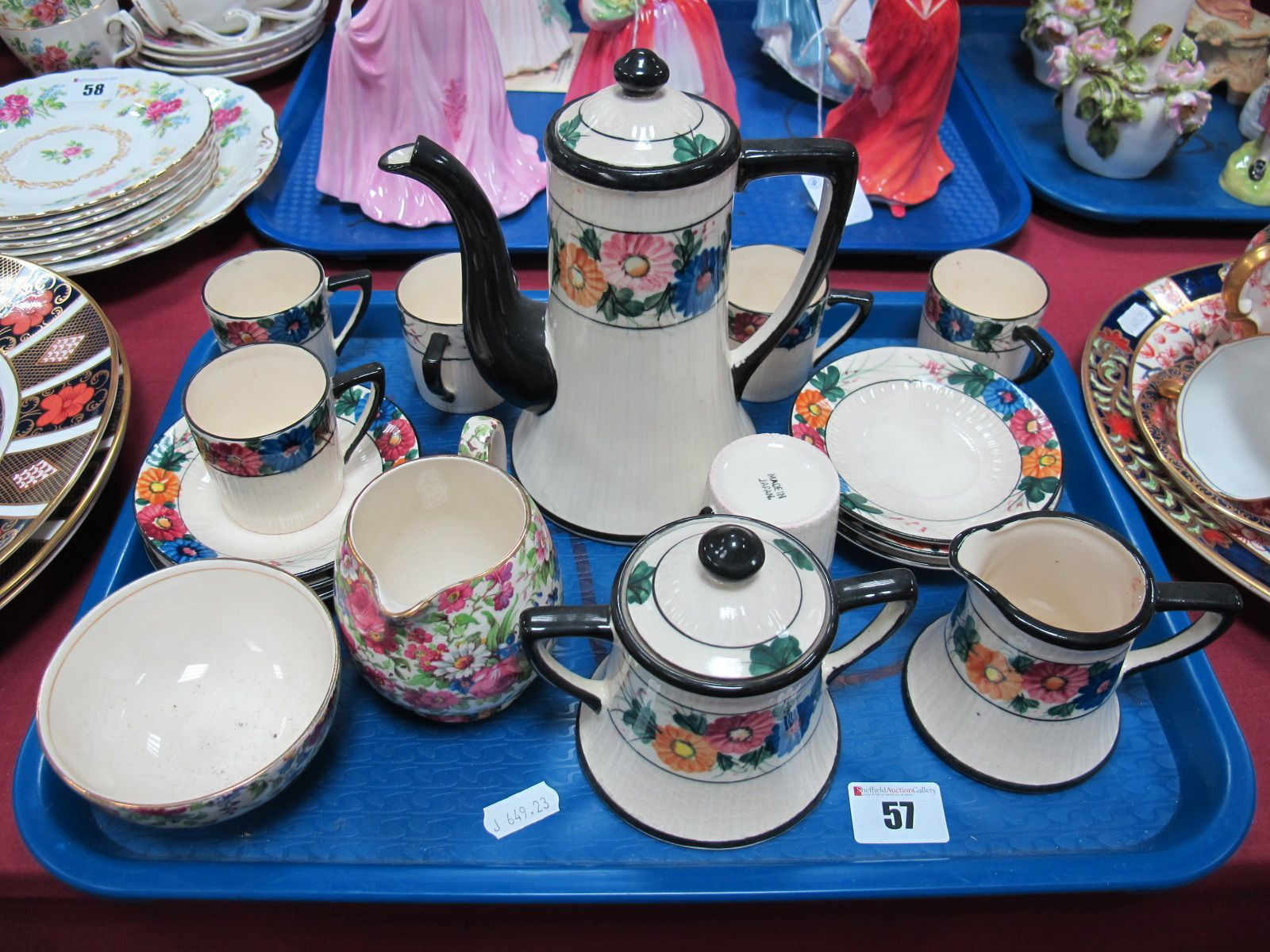 Lot 57 - A Japanese Marumon Pottery Coffee Service, with handpainted flowerhead borders, and a Royal