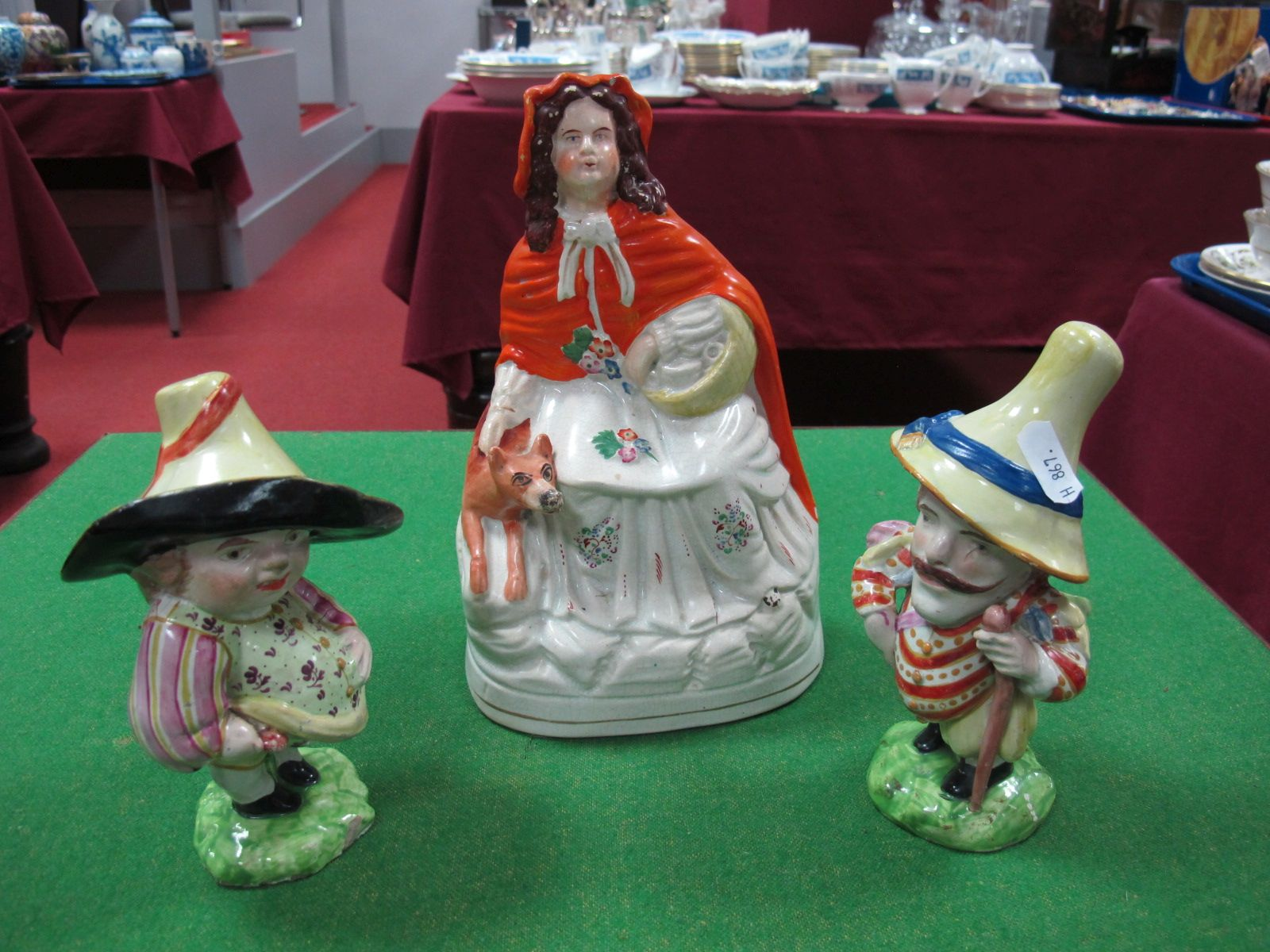 """Lot 93 - A Mid Victorian Staffordshire Flatback of Red Riding Hood including two glazed pottery """"Mansion"""