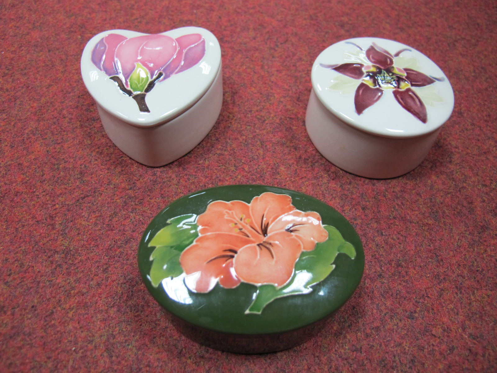 Lot 30A - Three Modern Moorcroft Trinket Jars and Covers, including Magnolia, Columbine and Hibiscus,