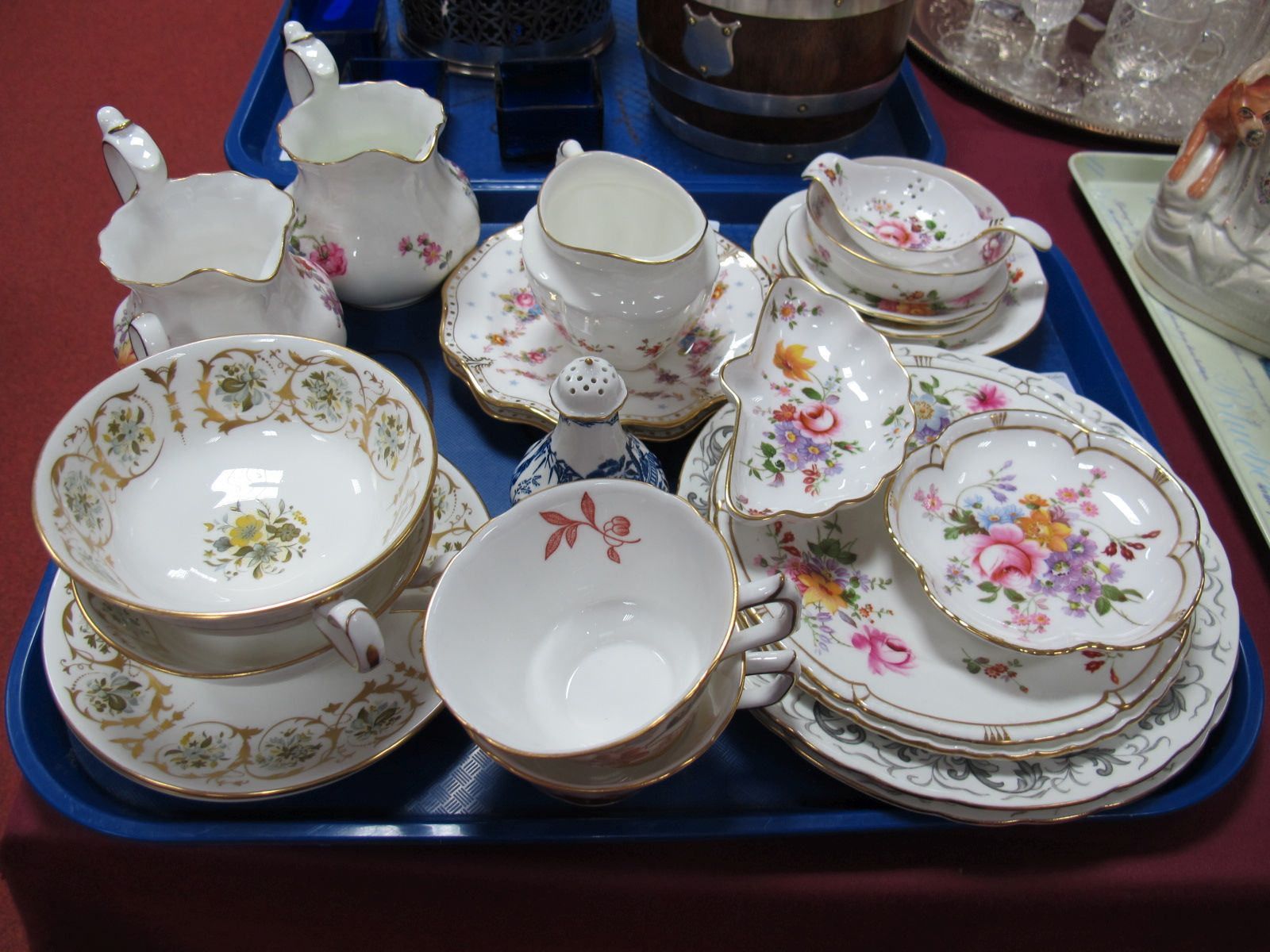 Lot 92 - Royal Crown Derby 'Derby Posies' Jugs, saucers, tea strainer on stand, tea plates, etc; together