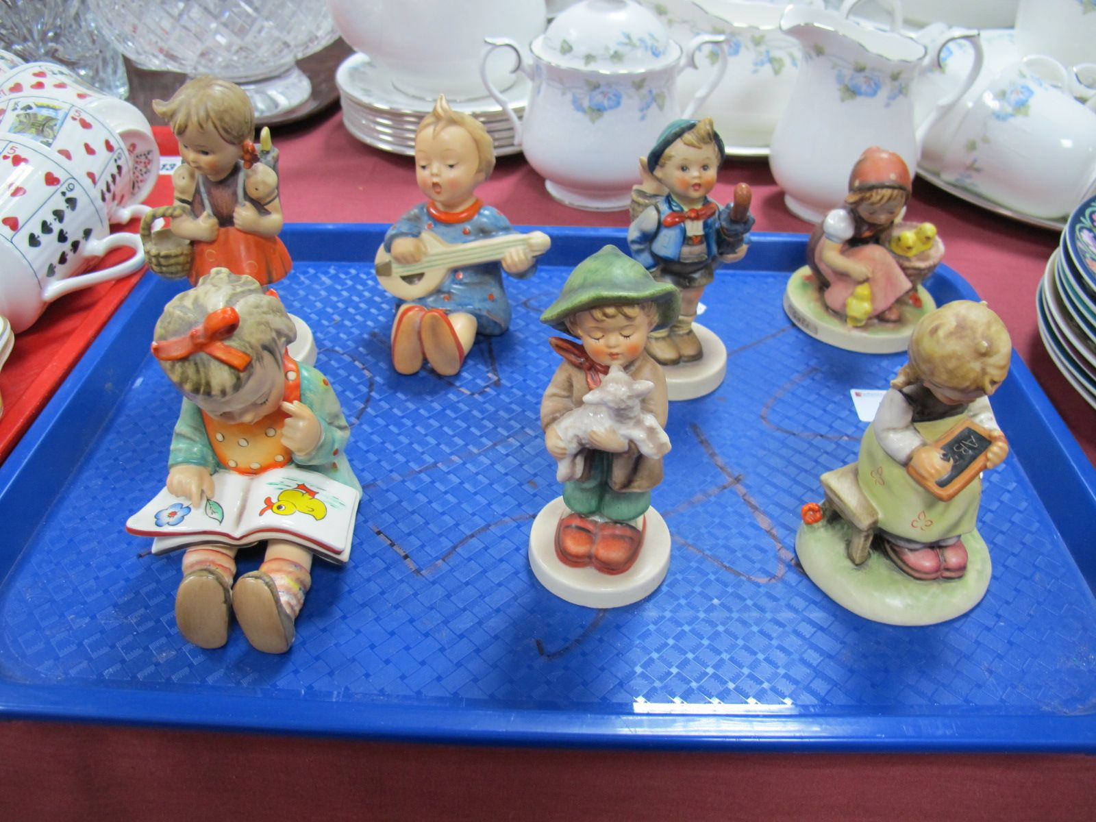 Lot 11 - Seven Hummel Figures, including Chick Girl, Seated Girl with Guitar, Boy with Umbrella, Seated