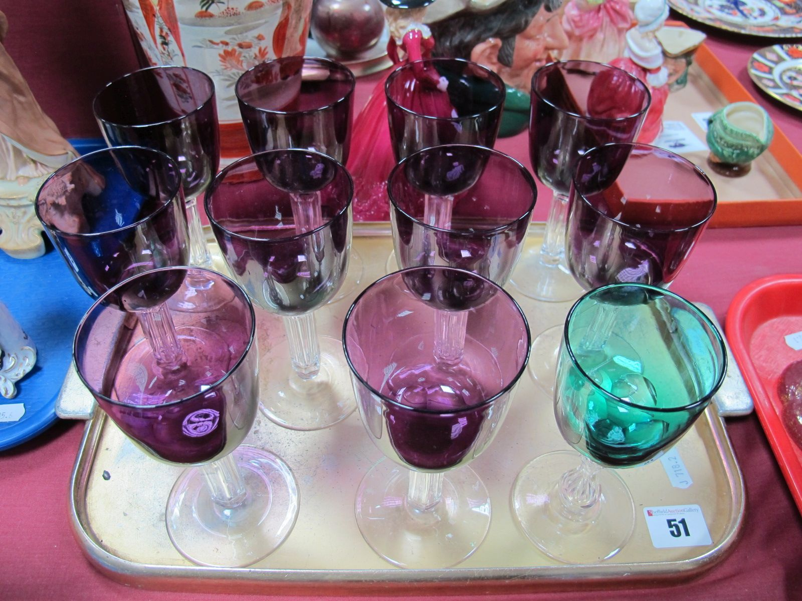 Lot 51 - A Set of Ten Wine Glasses, amethyst bowl, faceted stems on circular spreading feet, and a green