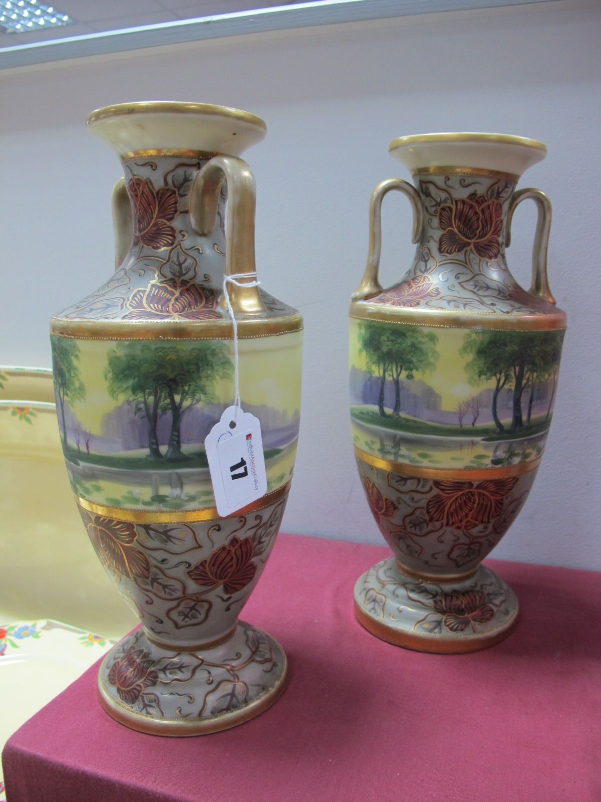 Lot 17 - *WITHDRAWN* A Pair of Noritake Ovoid Vases, circa 1920's, each handpainted with woodland landscapes,