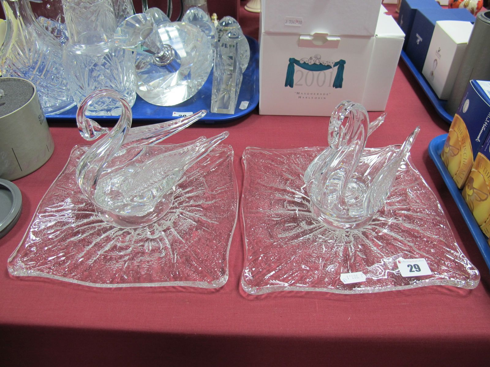 Lot 29 - A Pair of Moulded Glass Model Swans, each resting on shaped square stands.