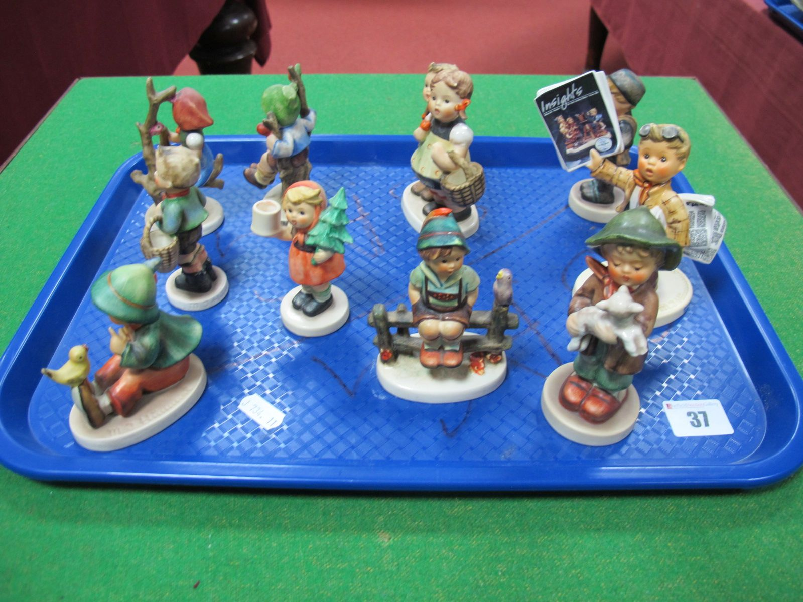 Lot 37 - A Collection of Ten Hummel Figures, including Exclusive Editions 'Insights' Newspaper Boy, Boy on