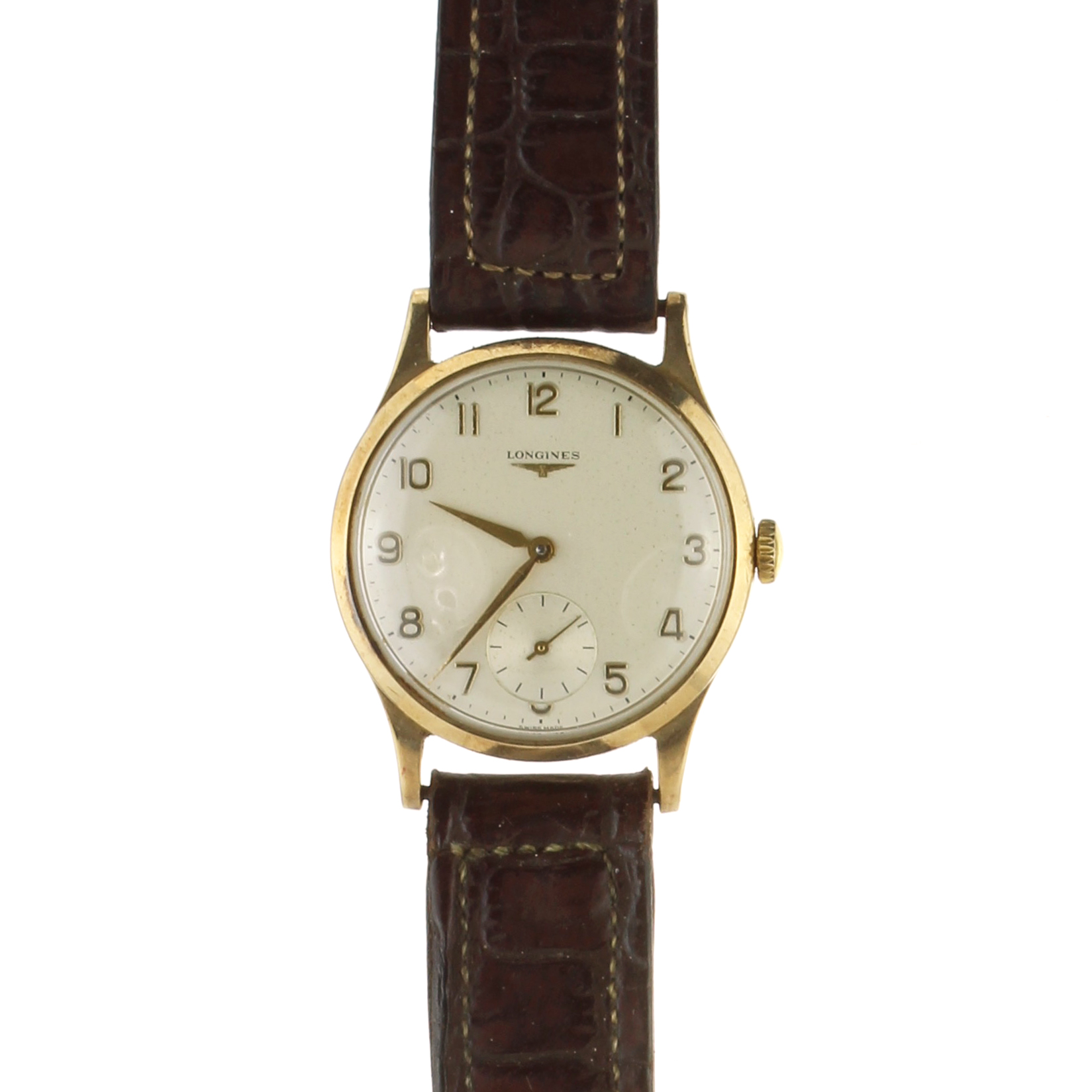 LONGINES A 9ct yellow gold wristwatch by Longines on a leather strap.