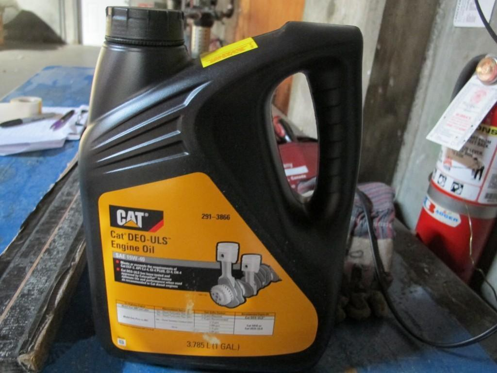 Engine oil  Cat DEO-ULS  SAE 15W-40  One gallon bottles  Two and a