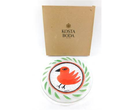 A Kosta Body Somebody glass dish, designed by Ulrica Hydman-Vallien, painted with a red bird within a repeating leaf border,