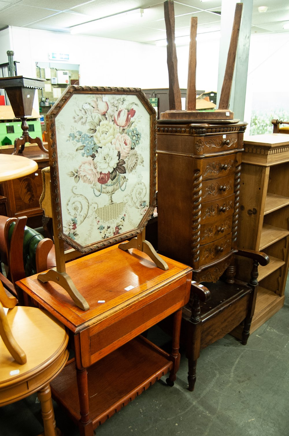 Lot 4 - A GILT FRAMED FIRE-SCREEN AND A CIRCULAR TOP TABLE, ON TRIPLE SUPPORTS AND A TWO TIER TEA TROLLEY (