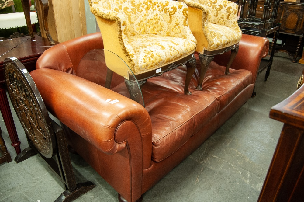 Lot 29 - A LARGE TWO SEATER TAN LEATHER SETTEE
