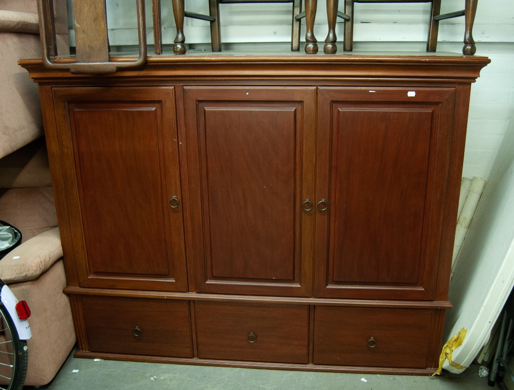 Lot 16 - A LARGE MAHOGANY THREE DOOR TELEVISION AND STEREO CABINET, RAISED ON BUN FEET