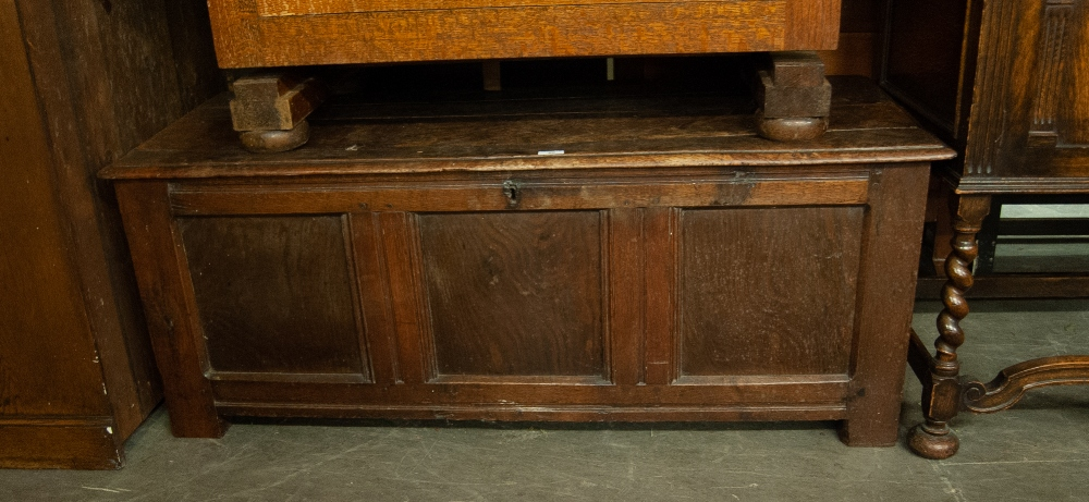 Lot 60 - AN ANTIQUE OAK COFFER WITH THREE PANEL FRONT (A.F.)