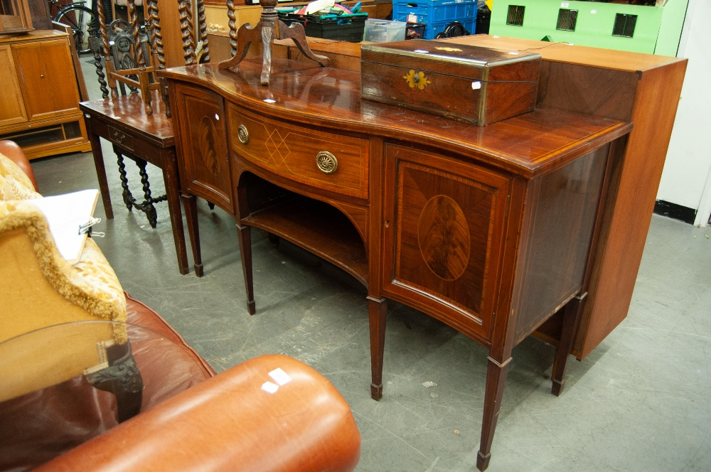 Lot 67 - AN EDWARDIAN INLAID MAHOGANY SERPENTINE FRONT SIDEBOARD, TWO CUPBOARDS FLANKING ONE LARGE CENTRAL