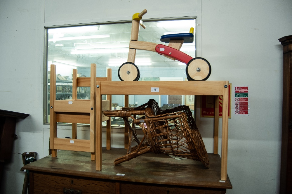 Lot 45 - A CHILD'S WOODEN PUSH-ALONG BIKE WITH PAINTED SEAT, A CHILD'S TABLE AND CHAIRS SET AND A CHILD'S