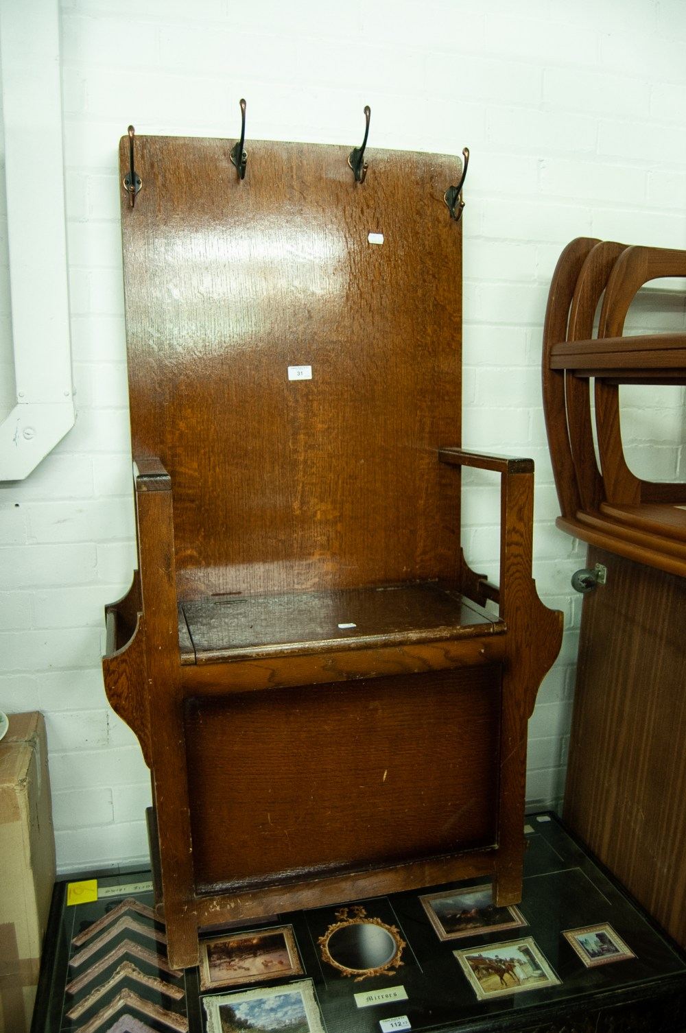 Lot 31 - AN OAK HALLSTAND WITH LIFT UP SEAT (CUT DOWN)
