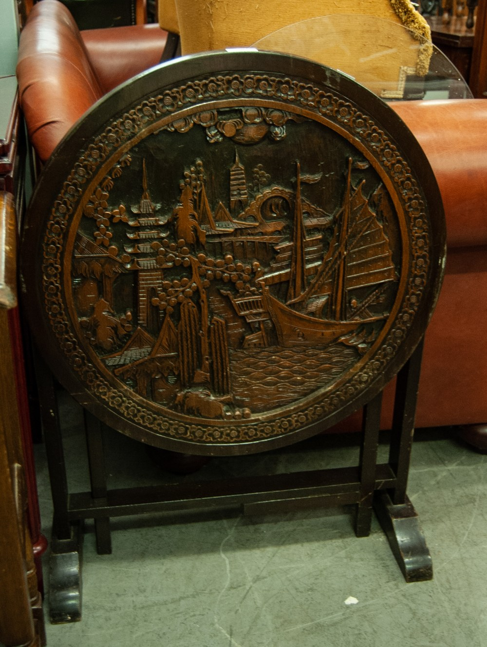 Lot 8 - A MODERN ORIENTAL HIGH RELIEF CIRCULAR TABLE, FEATURING A NAUTICAL SCENE AND FOLIAGE, ON FOUR