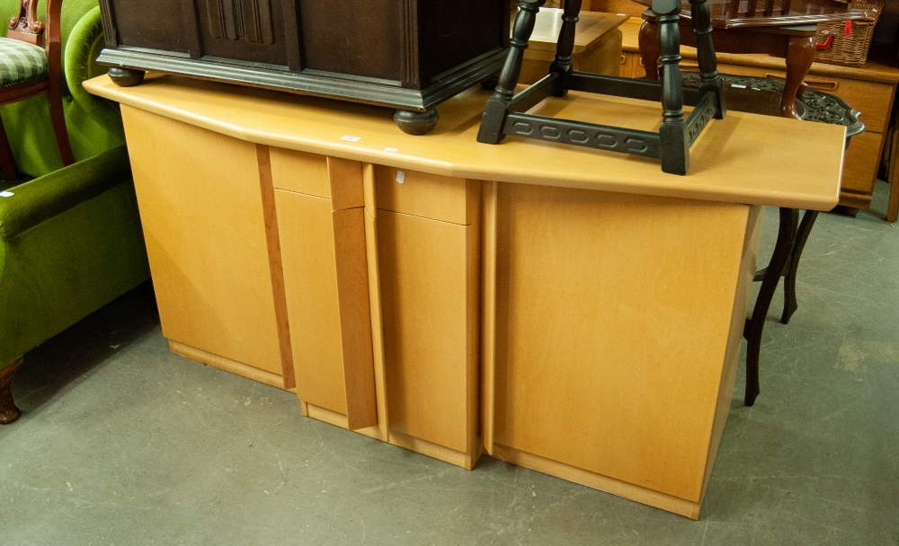 Lot 23 - A LARGE BEECHWOOD MODERN SIDEBOARD WITH FOUR CUPBOARDS AND A SINGLE CENTRAL DRAWER WITH SHAPED TOP