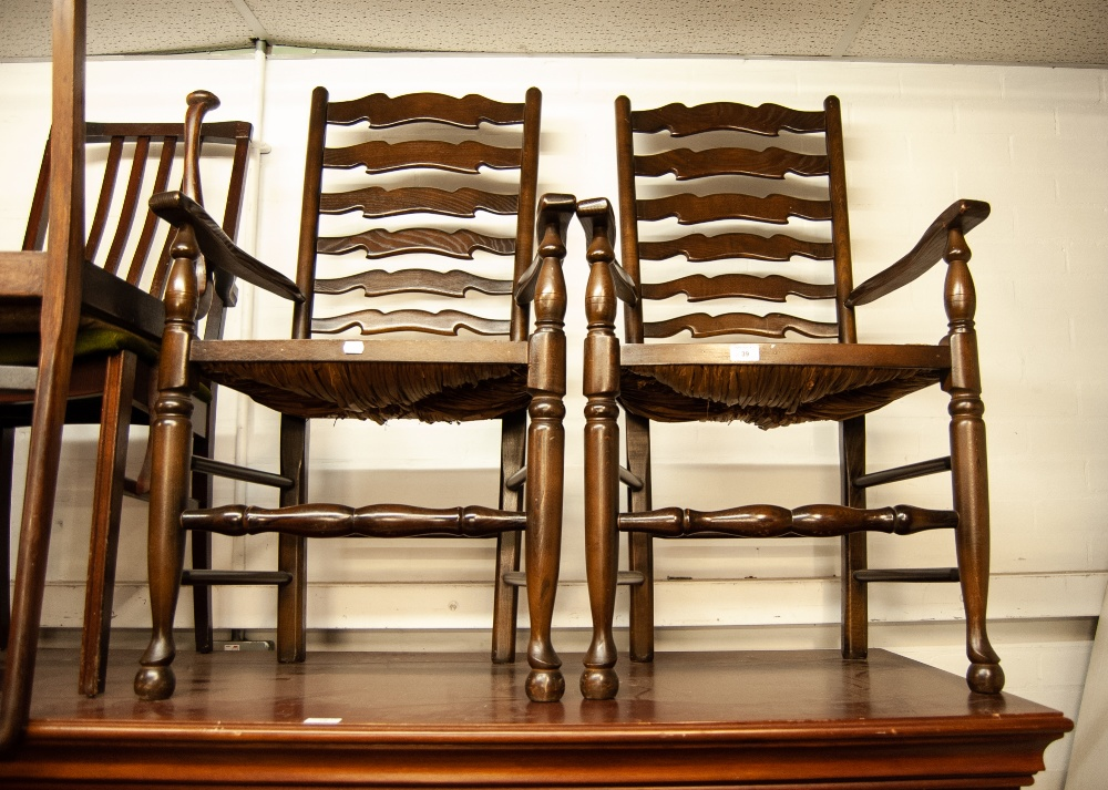 Lot 39 - A PAIR OF REPRODUCTION OAK CARVED CHAIRS, LADDER BACKS WITH RUSH SEATS (2)