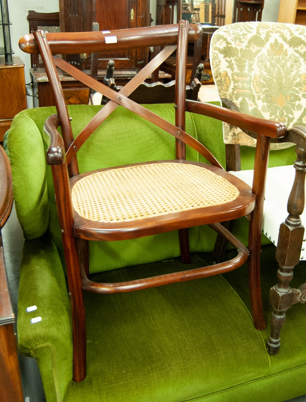 Lot 1 - A MODERN MAHOGANY ARMCHAIR, WITH 'X' BACK, CANE SEAT, A PAD TOP STOOL, ON CABRIOLE SUPPORTS (2)