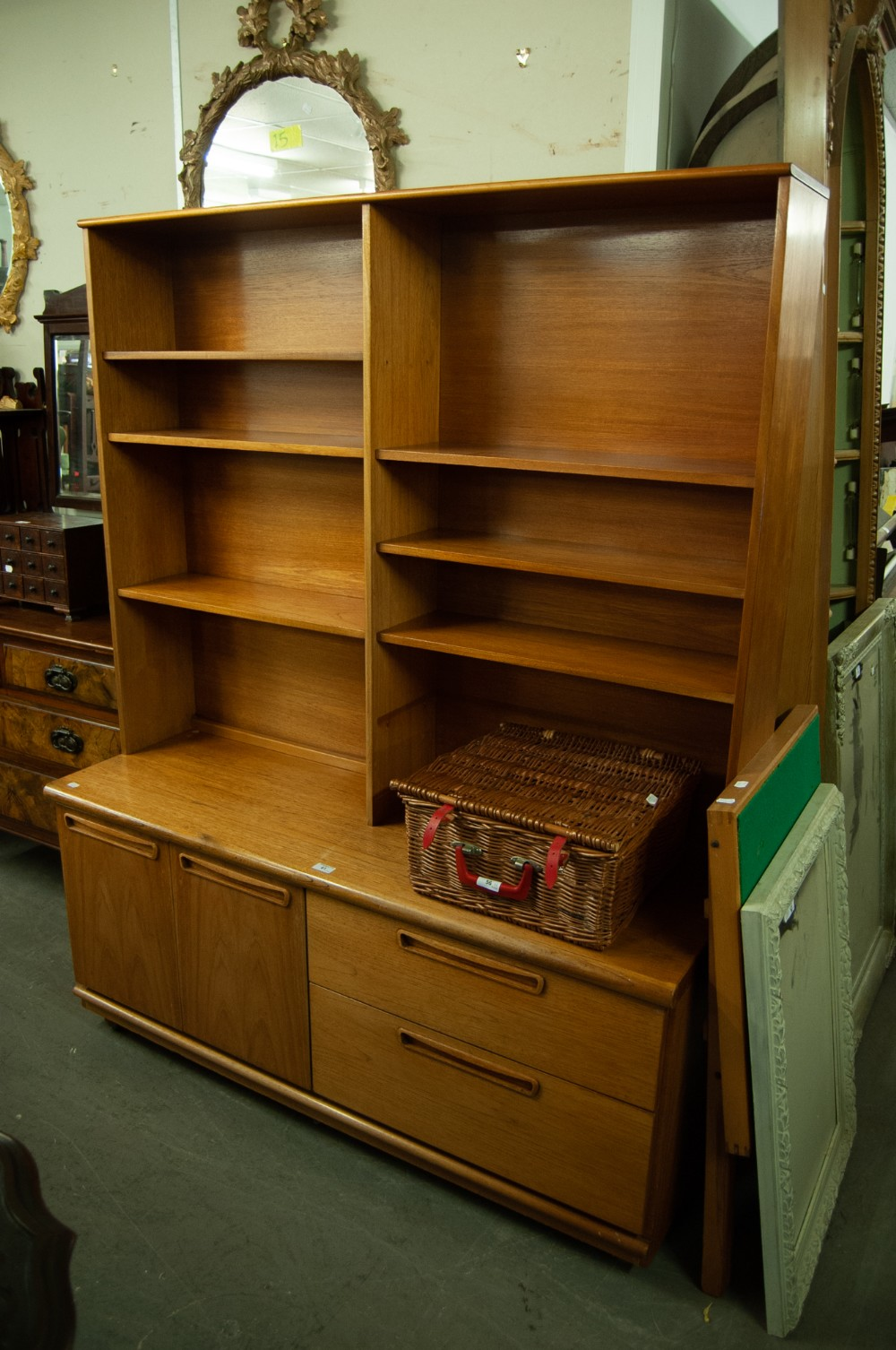 Lot 61 - A TEAK OPEN BOOKCASE/DISPLAY CABINET ABOVE CUPBOARD AND TWO DRAWER BASE