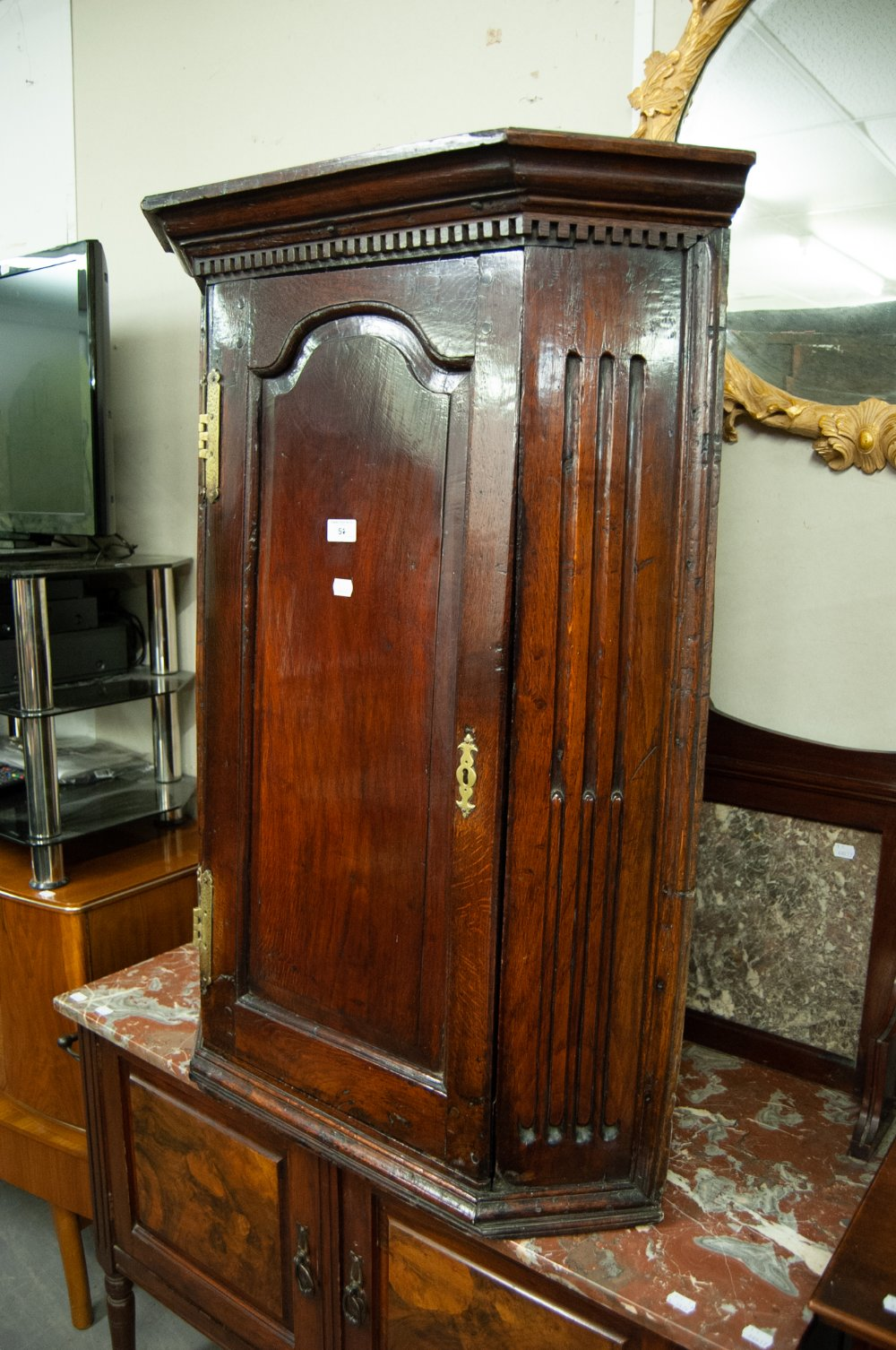 Lot 51 - A NINETEENTH CENTURY JACOBEAN REVIVAL OAK CORNER CUPBOARD WITH STEPPED CORNICE OVER CHAMFERRED