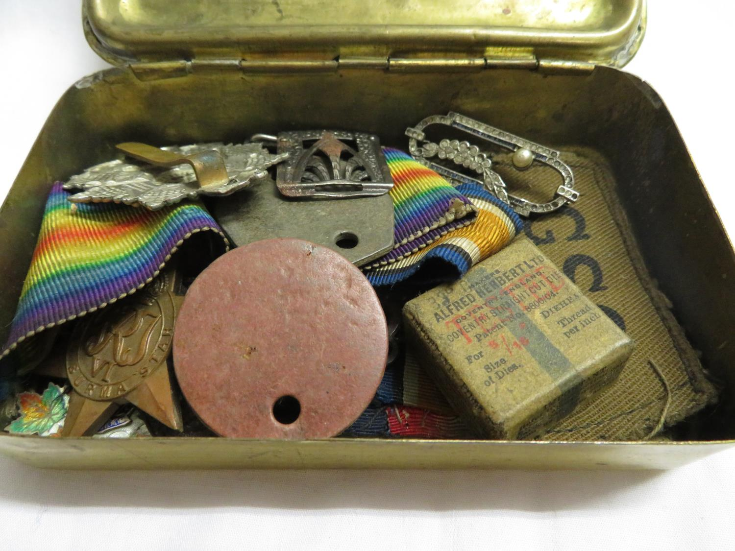 Lot 36 - WWI Christmas box containing sweetheart brooches, fobs and other militaria including dog tags