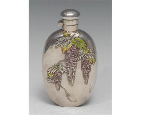 A Japanese silver and enamel oval hip flask, applied and decorated in polychrome with wisteria, hinged bayonet cap, 14cm long
