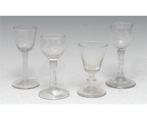 A George III opaque twist cordial glass, shallow trumpet bowl etched with a ho-ho bird and hops, circular foot, polished pont