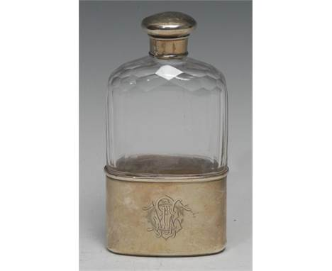 A Victorian silver and clear glass hip flask, screw-fitting cover, stirrup cup to base, 15cm long, London 1880
