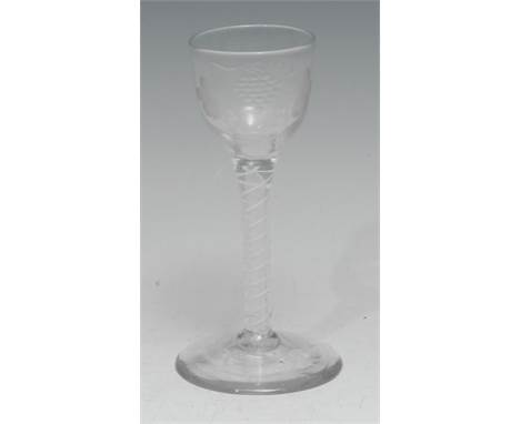 A George III opaque twist cordial glass, the bowl etched with fruiting vine, circular foot, polished pontil, 14cm high, c. 17