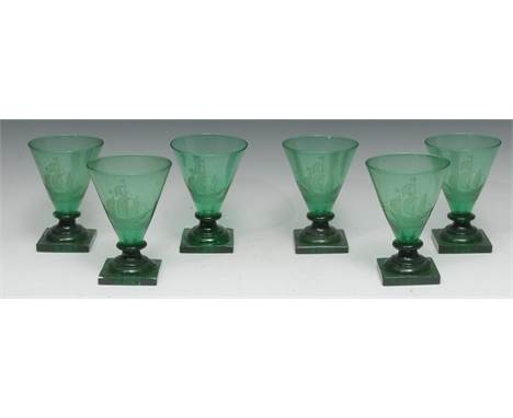 A set of six Art Deco green glass drinking glasses, each conical-shaped bowl engraved with a galleon, square pedestals, 'lemo