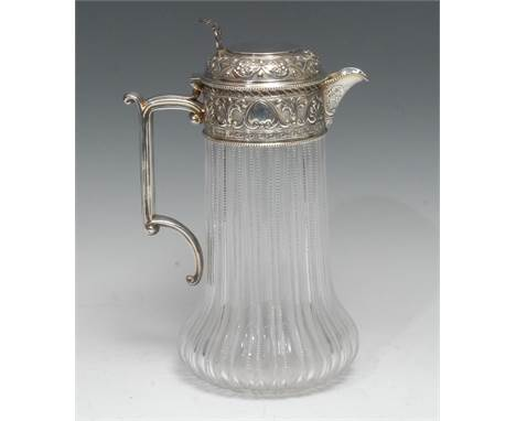 A large Victorian silver mounted cut-glass claret jug, hinged cover with pierced thumbpiece, chased with palmettes, cartouche