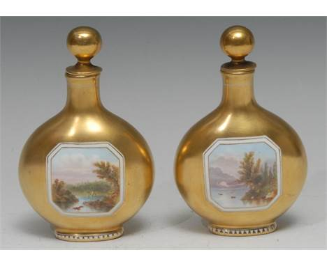 A pair of Coalport pilgrim flask scent bottles, each painted with a canted rectangular landscape vignette on a gilt ground, g