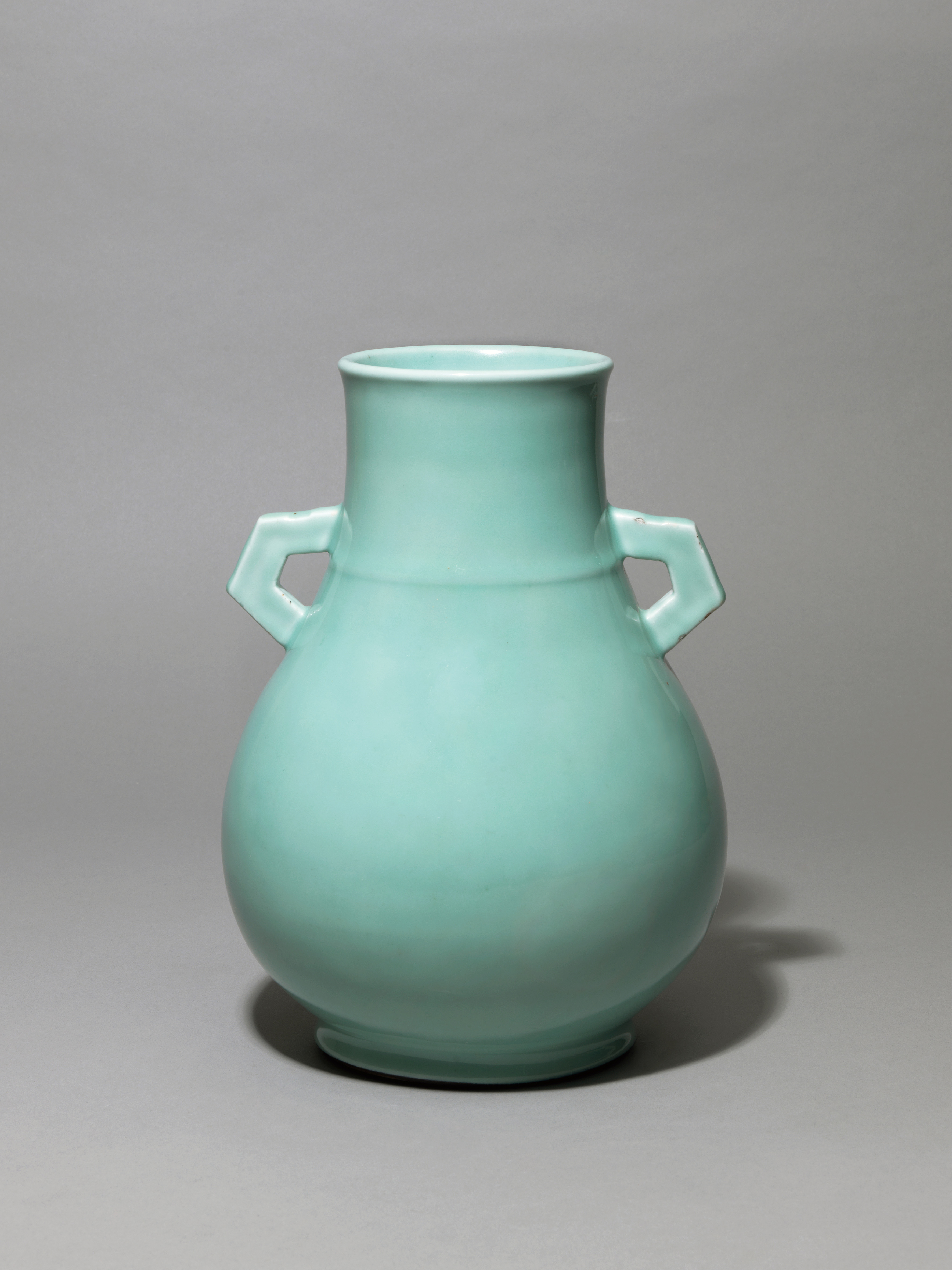Lot 13 - An archic-form vase decorated with a pale blue Guan-type glaze, Qing Dynasty, Qianlong period