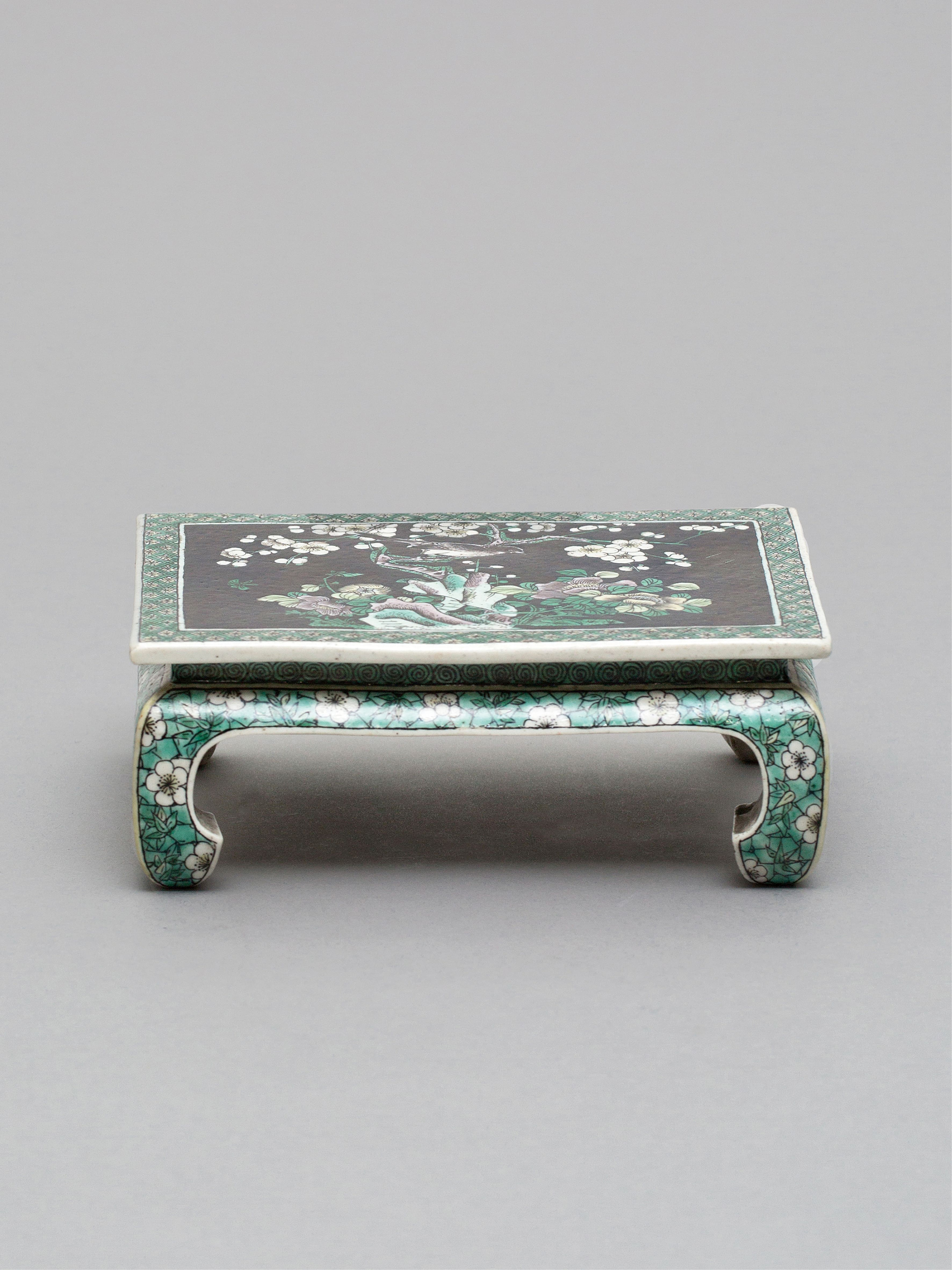 Lot 55 - A rectangular 'famille-noire' miniature table Qing Dynasty, Kangxi Period