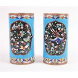 A pair of 19th century Chinese cloisonne enamelled cylinder vases with phoenix and butterfly