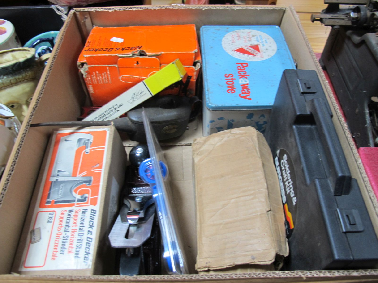 Lot 679 - A Soldering kit, oil stove, drill stand, Stanley plane, drill bit sharpener and other items:- One