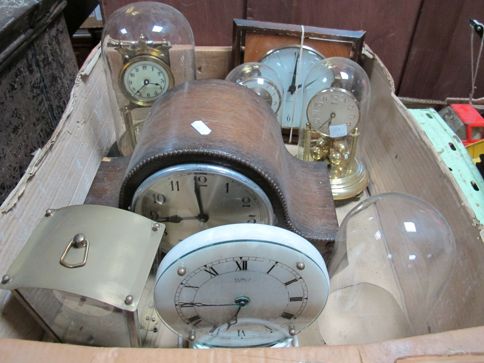 Lot 676 - An Oak Cased Mantel Clock, a Temco electric marble clock, Paico and Bentima Anniversary clock,