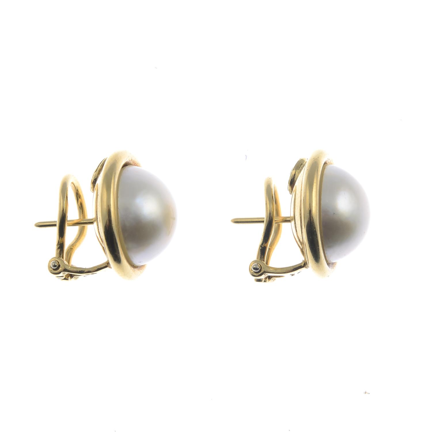 Lot 59 - A pair of 18ct gold mabe pearl earrings.Hallmarks for Sheffield.Diameter 1.7cms.