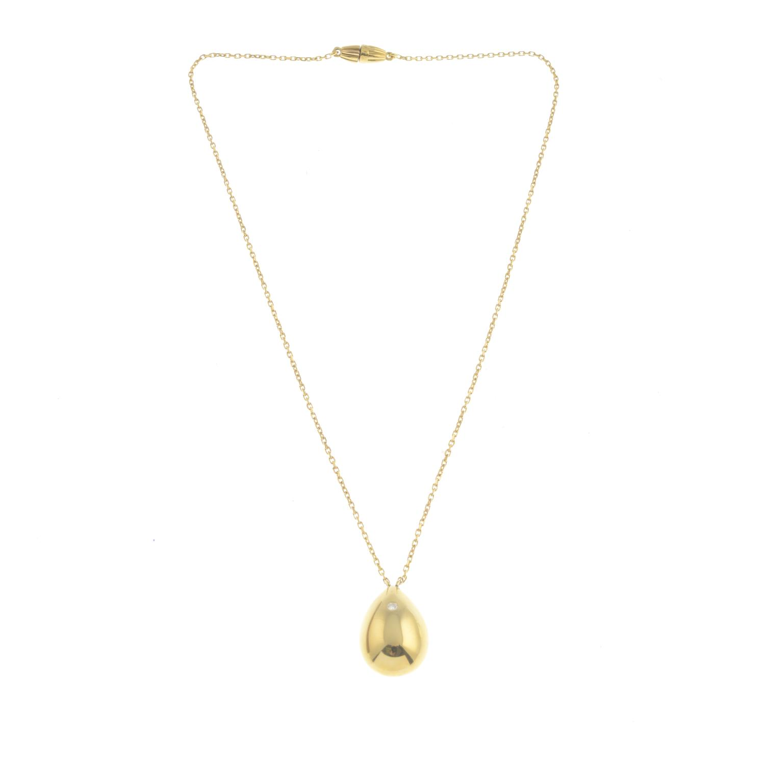 Lot 49 - A diamond pendant, suspended from a trace-link chain.Signed Ritz.