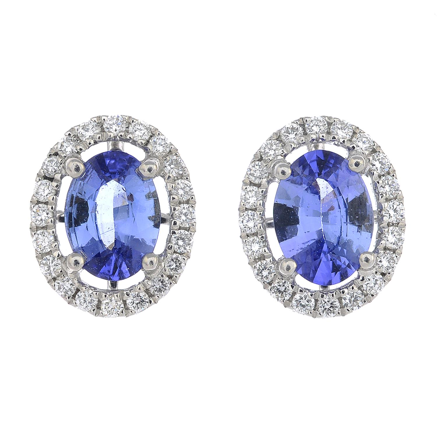 Lot 24 - A pair of sapphire and diamond cluster earrings.Total sapphire weight 1.73cts.Total diamond weight
