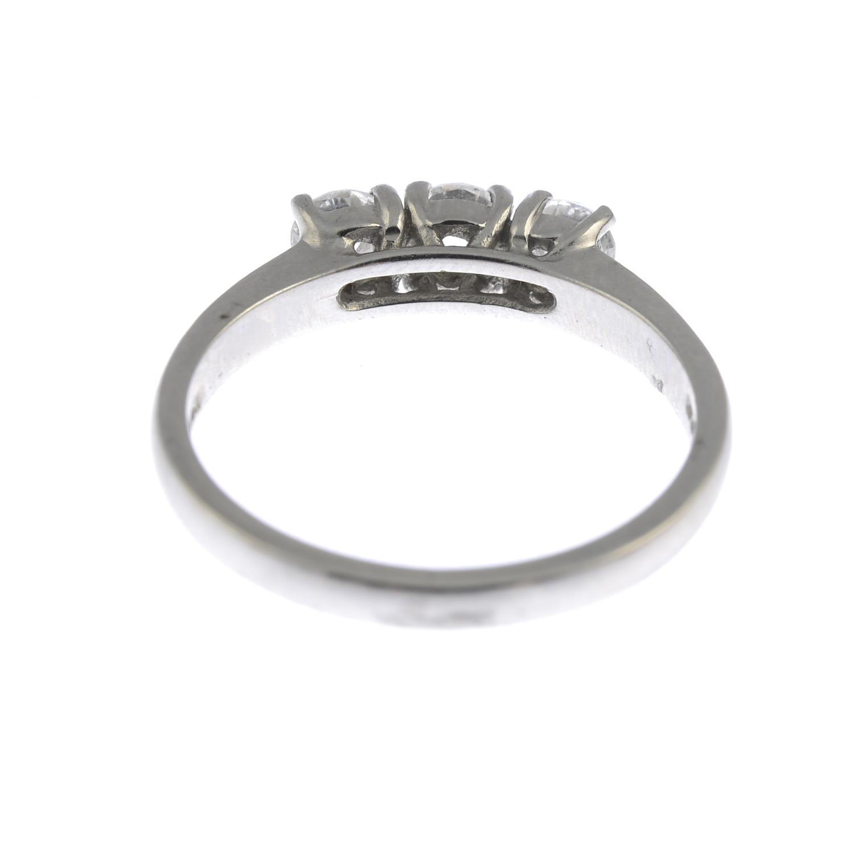 Lot 34 - A platinum diamond three-stone ring.Estimated total diamond weight 0.60ct, I-J colour, SI clarity.