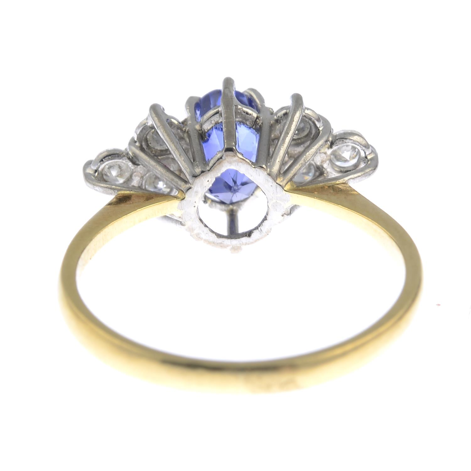 Lot 6 - An 18ct gold sapphire and diamond ring.Sapphire calculated weight 1.35cts,